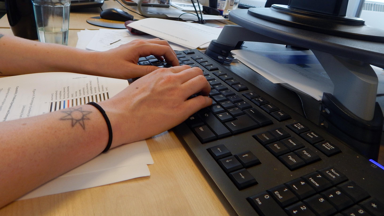 Woman at computer keyboard