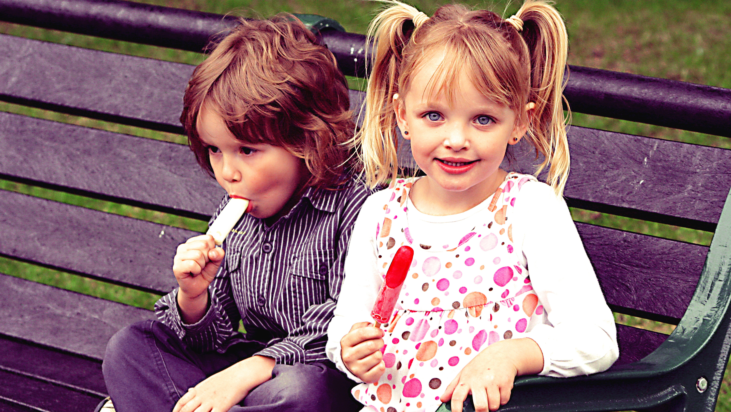 Brother and sister eating lollies. Photo by Emy Lou Photography