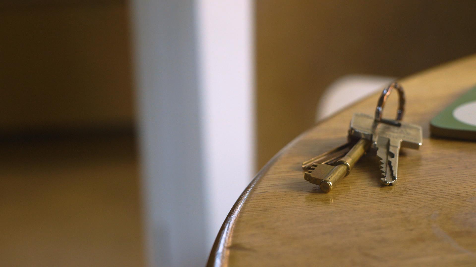Front door keys on table