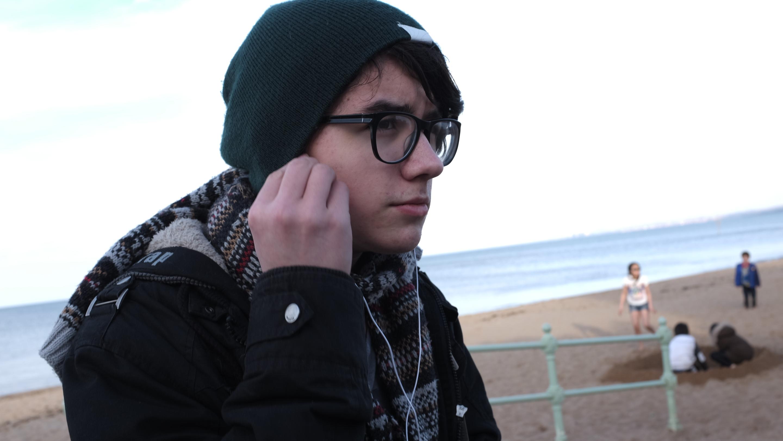 Teenage boy with headphones. Photo by Walter Scott