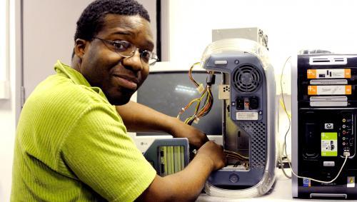 Man mending computer