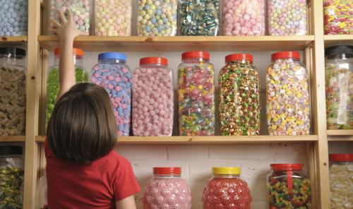 A small child in a sweet shop