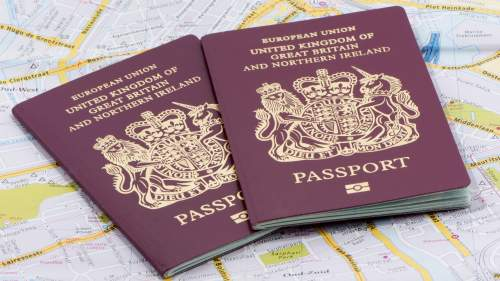 Two passports lying on a map