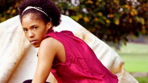 Young black woman in pink top by Emy Lou Photography
