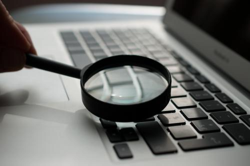 Magnifying glass near laptop. Photo by Agence Olloweb on Unsplash