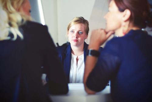 Three women at desk. Photo by Tim Gouw on Unsplash