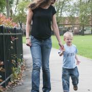 Mother and disabled son walking