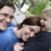 Lesbian couple hugging son