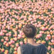 Woman looking at tulips